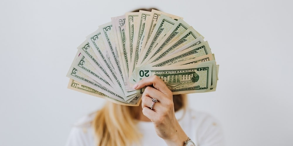 Woman Holding Money in Hand