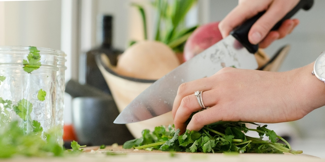 A Woman is Cutting Vegetables