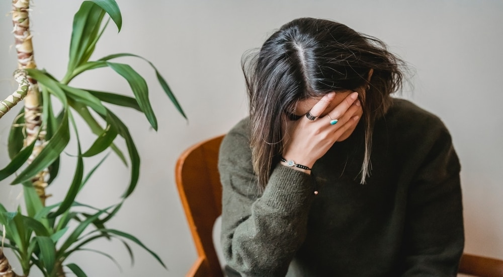 Worried Young Woman Covering Her Face